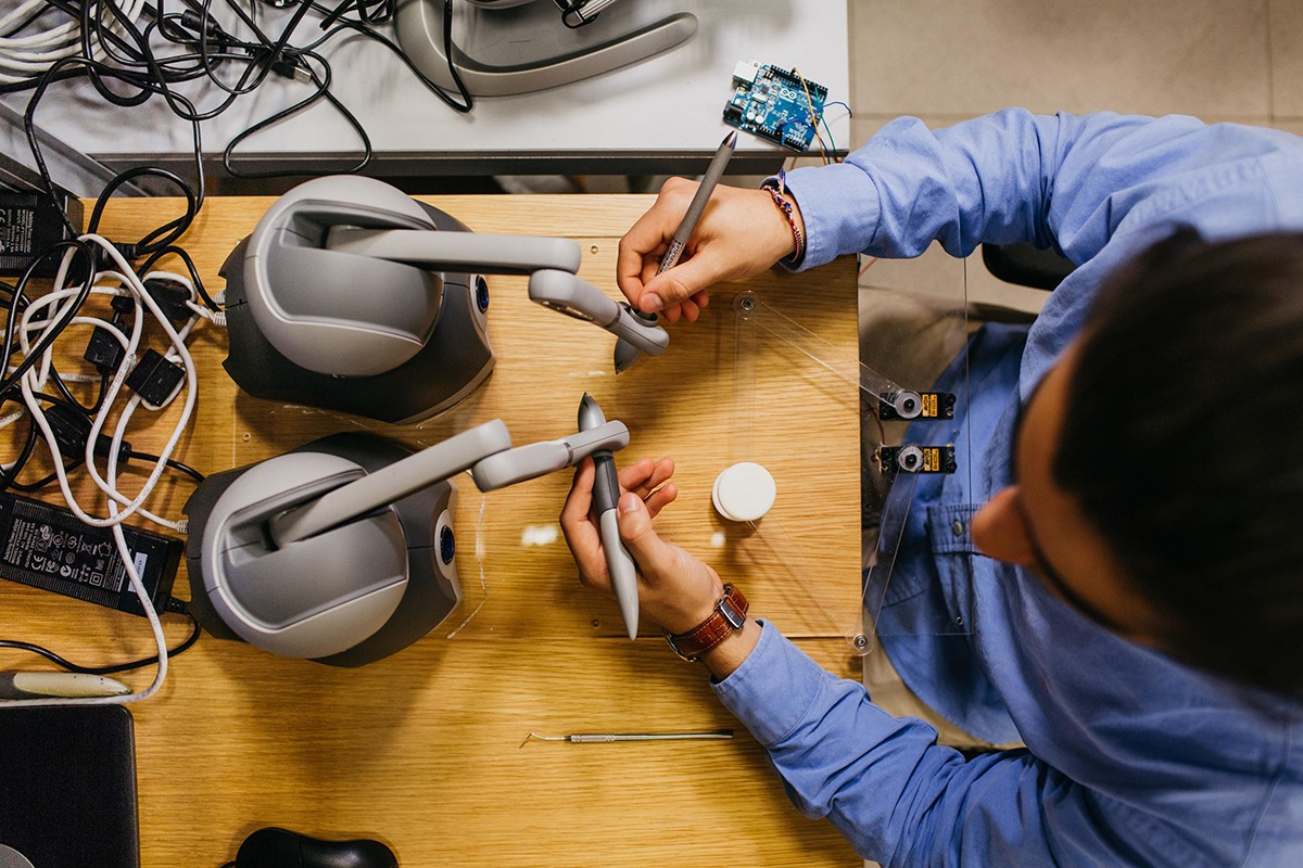 A computer engineering student at NYU Abu Dhabi tests a haptic device.