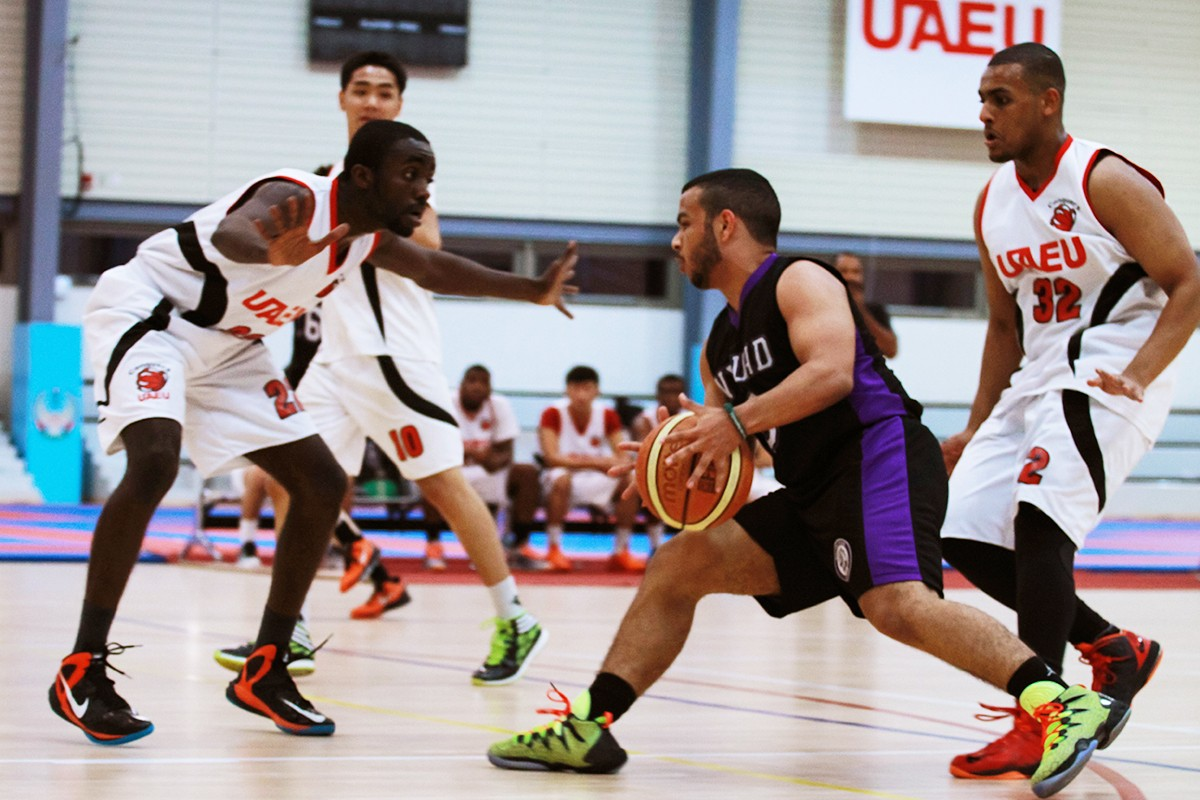 Men basketball team during a competition.