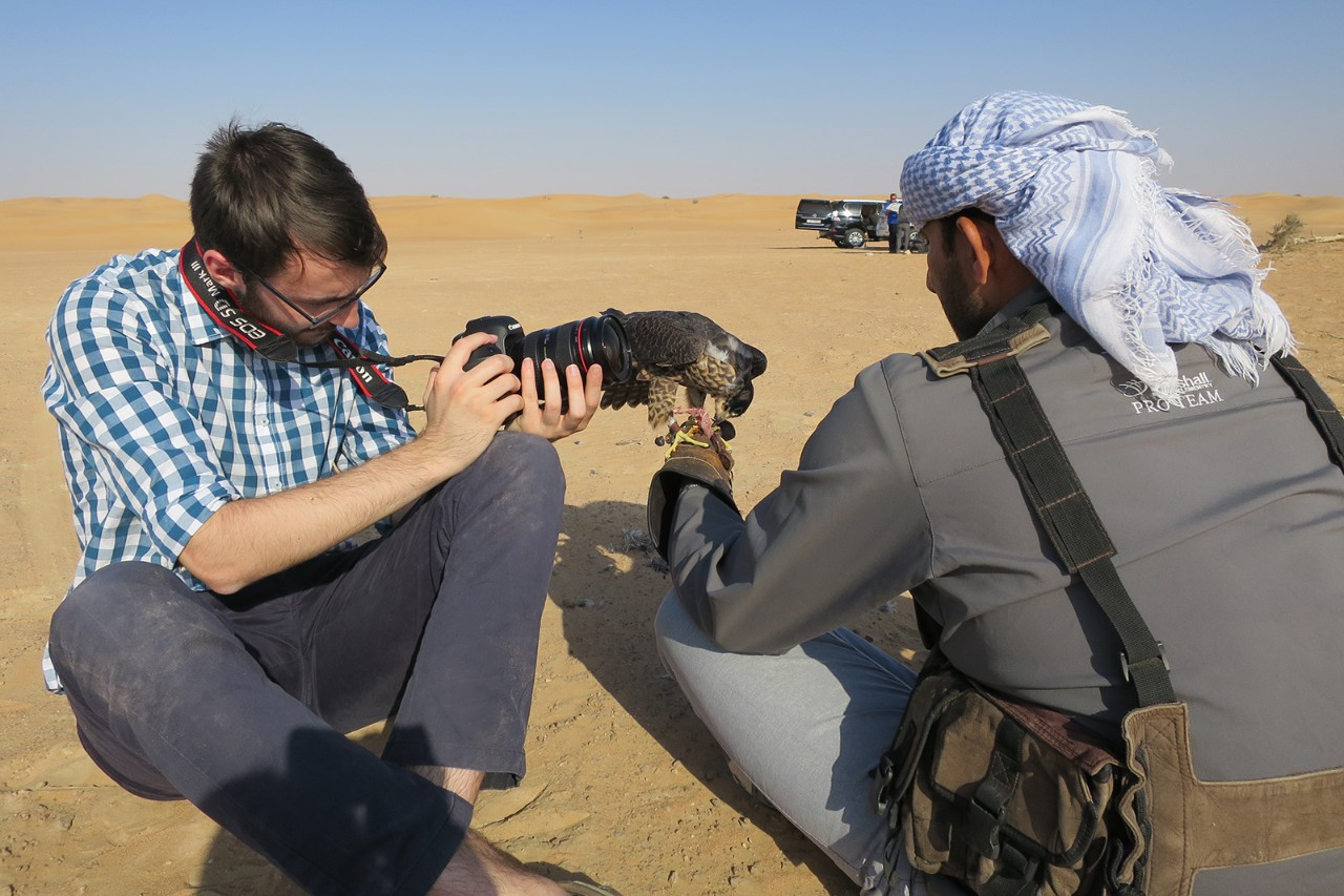 Samuel Ridgeway conducts filming in the desert for a Capstone documentary about falconry in the UAE.