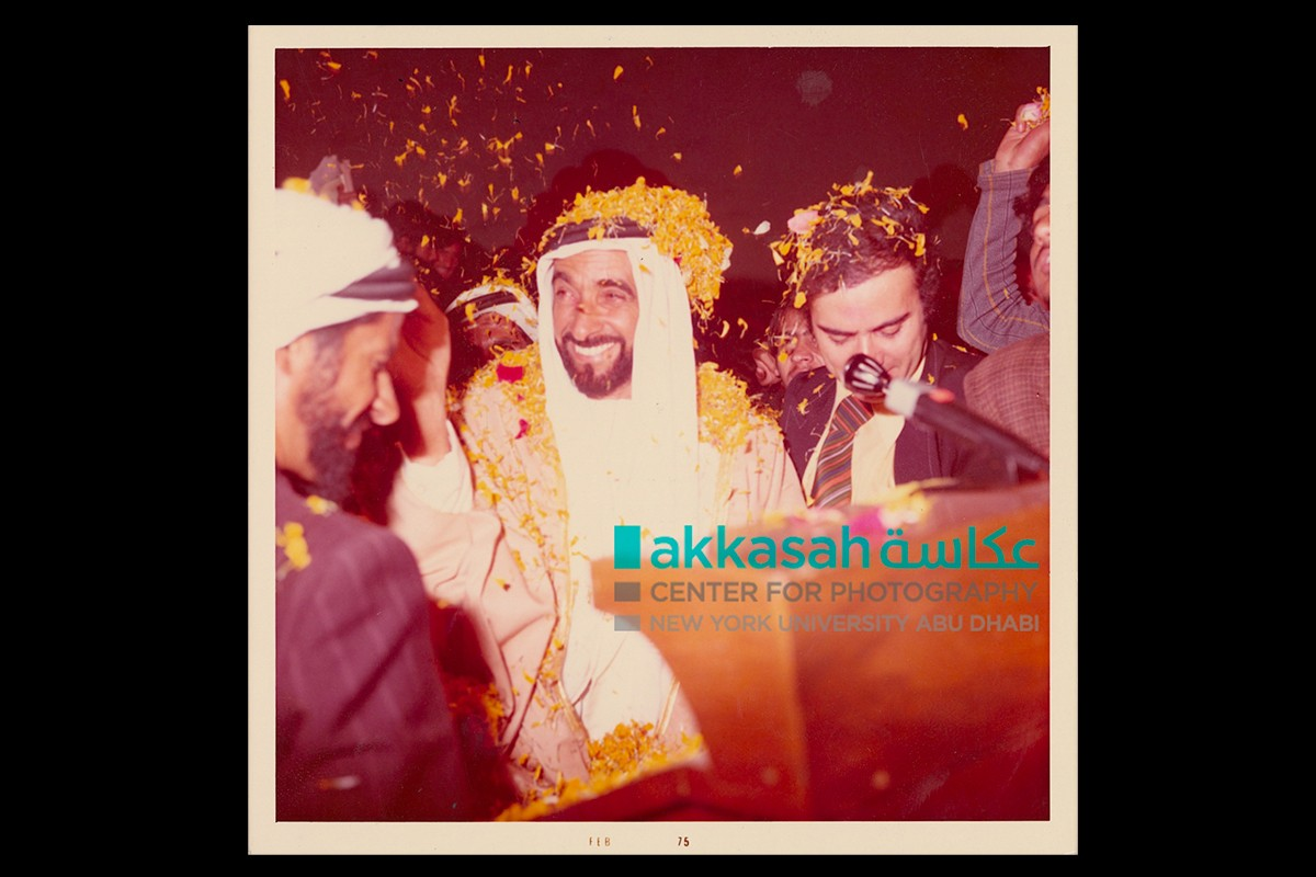 Sheikh Zayed and Zaki Nusseibeh covered in flower petals during a visit to India., February 1975.
