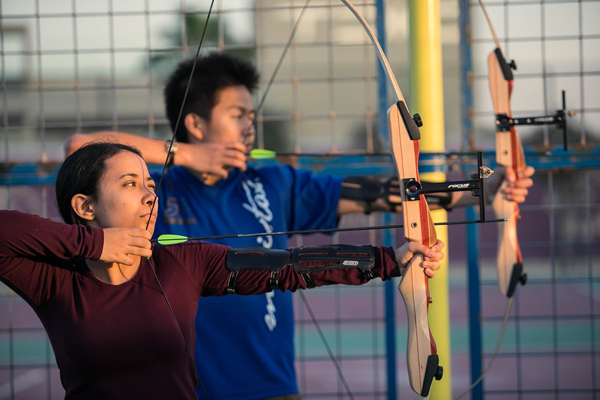"NYU Abu Dhabi students practice archery as part of the ""Oh Shoot"" archery Student Interest Group."