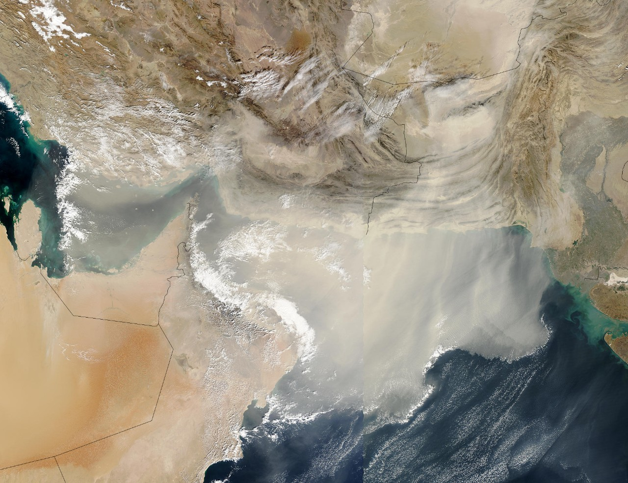 A massive dust storm blowing large quantities of dust out over the Gulf and Arabian Sea (December, 2003).