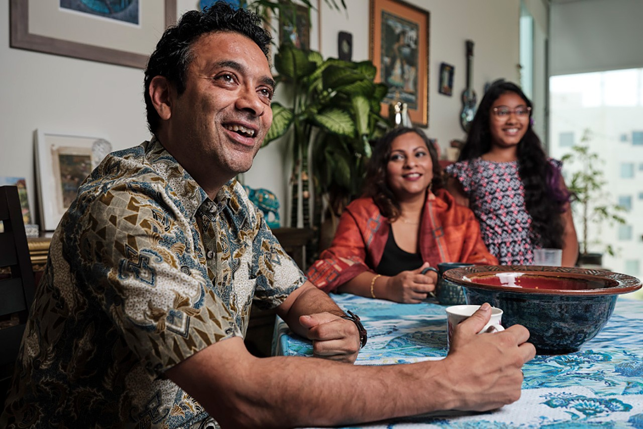 Assistant Professor of Biology Dipesh Chaudhury, left, and his family.