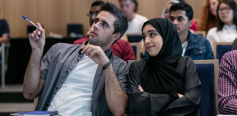 NYU Abu Dhabi students in a lecture hall.