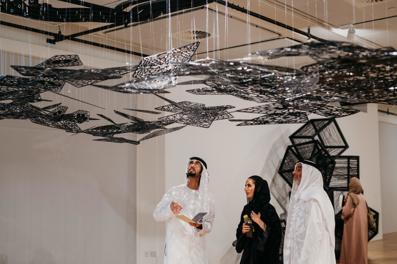 Visitors admire an art installation at the NYUAD Art Gallery.