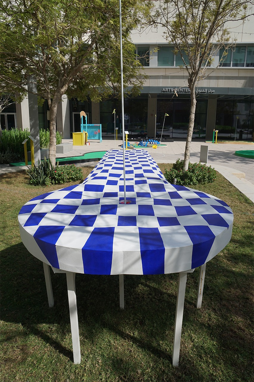Title of Installation: DRIVE Material: Flexible plywood (Bendy Ply), hard-wood, MDF wood, paint (white, blue) Dimensions: 88 x 82 x 513 cm Exhibition: Putting for Pleasure and Politics: A Playable Sculpture Garden The East Plaza, The Arts Center NYU Abu Dhabi November 12 – 25, 2018