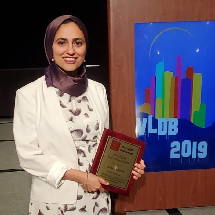 Computer scientist Azza Abouzeid accepts the Test of Time Award from Very Large Data Bases (VLDB).