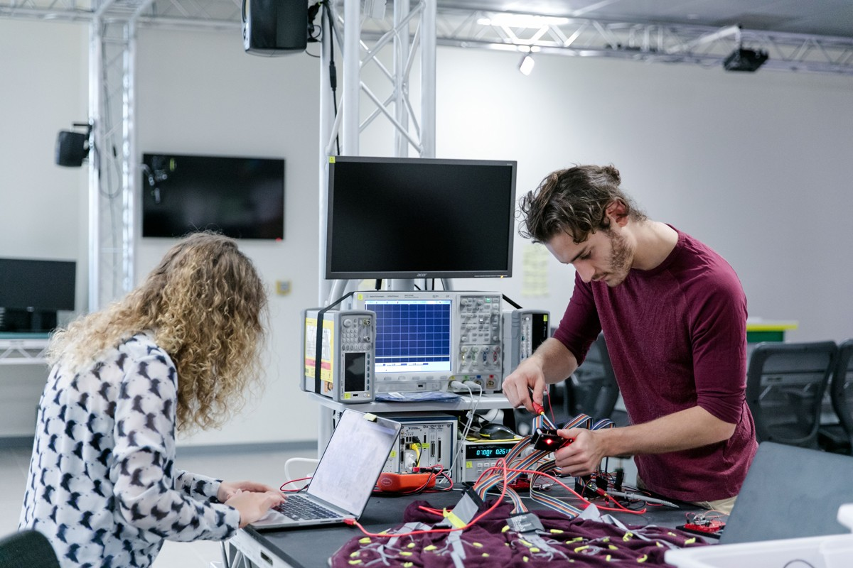 Beatrice Ionascu, an electrical engineering undergraduate student, works on a project at the Ideas Lab at the NYU Abu Dhabi campus on Saadiyat Island in Abu Dhabi.