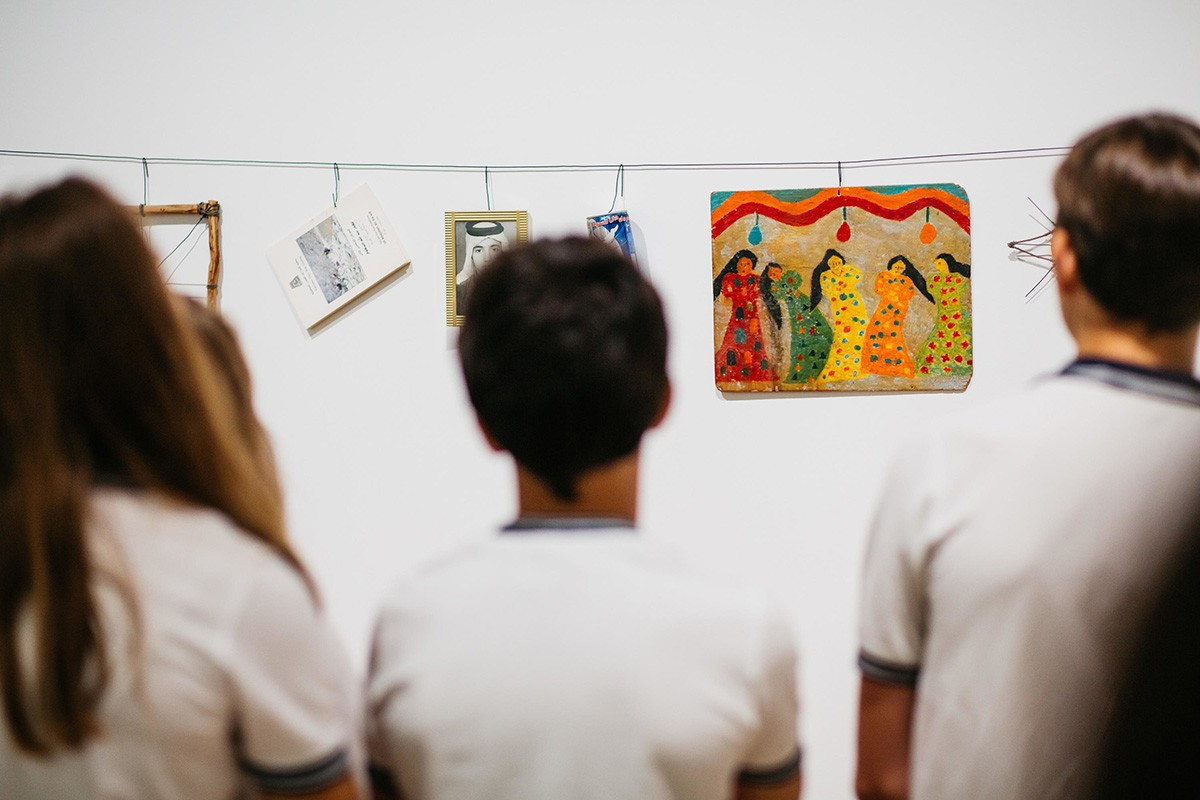 Students looking at art work.