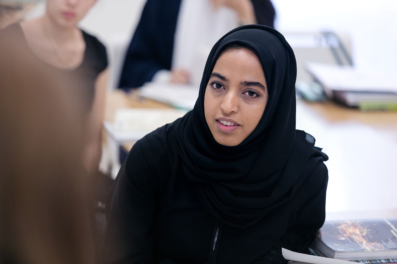 Student in class wearing abaya