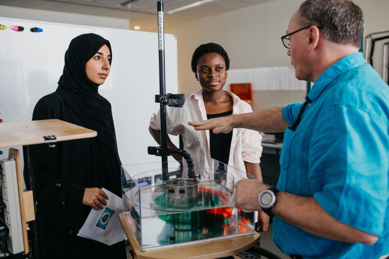 Students in class with Professor David Holland at NYU Abu Dhabi.