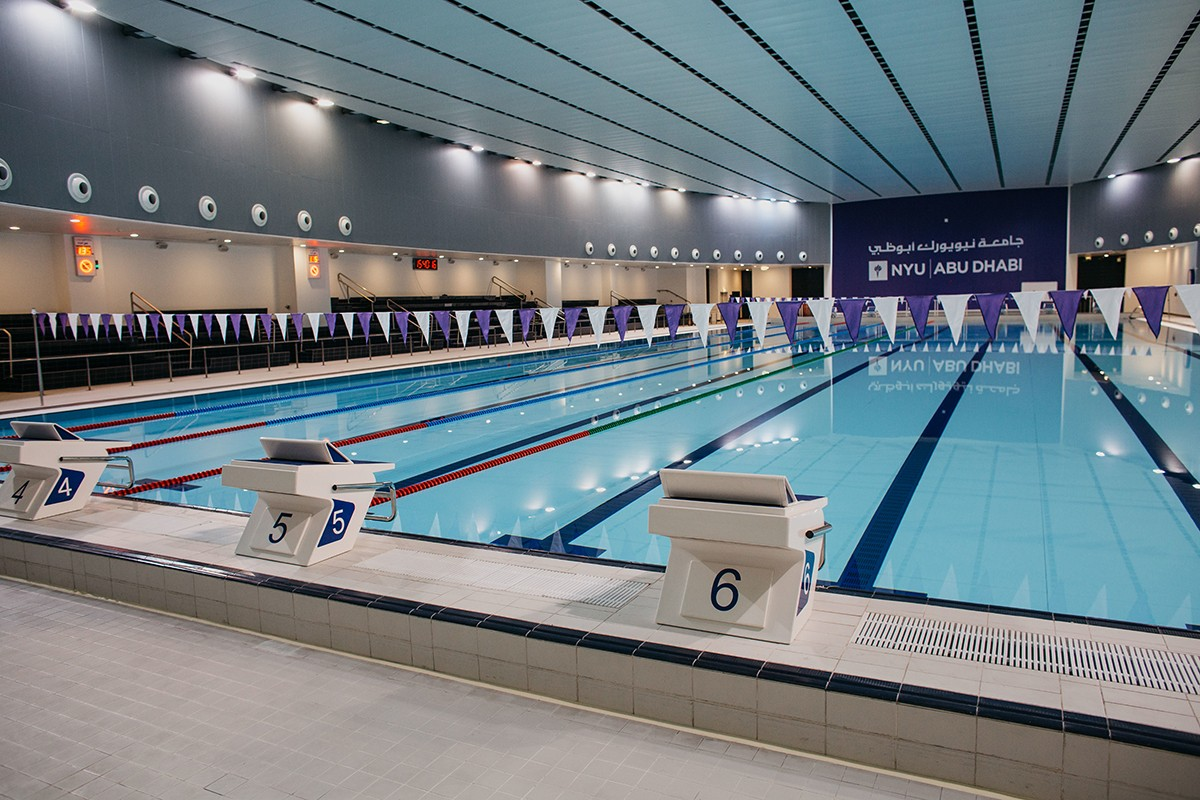 NYUAD's 50-meter indoor competition pool has a movable bulkhead and accommodates eight lanes.