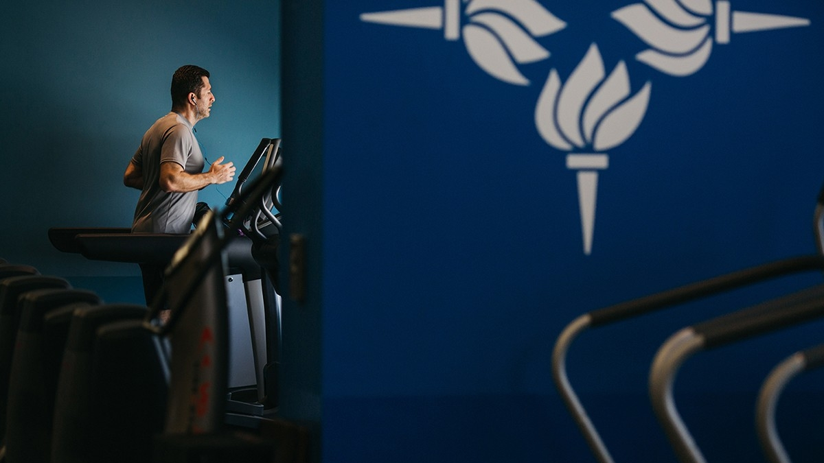 A runner using the treadmill in the Fitness Center.