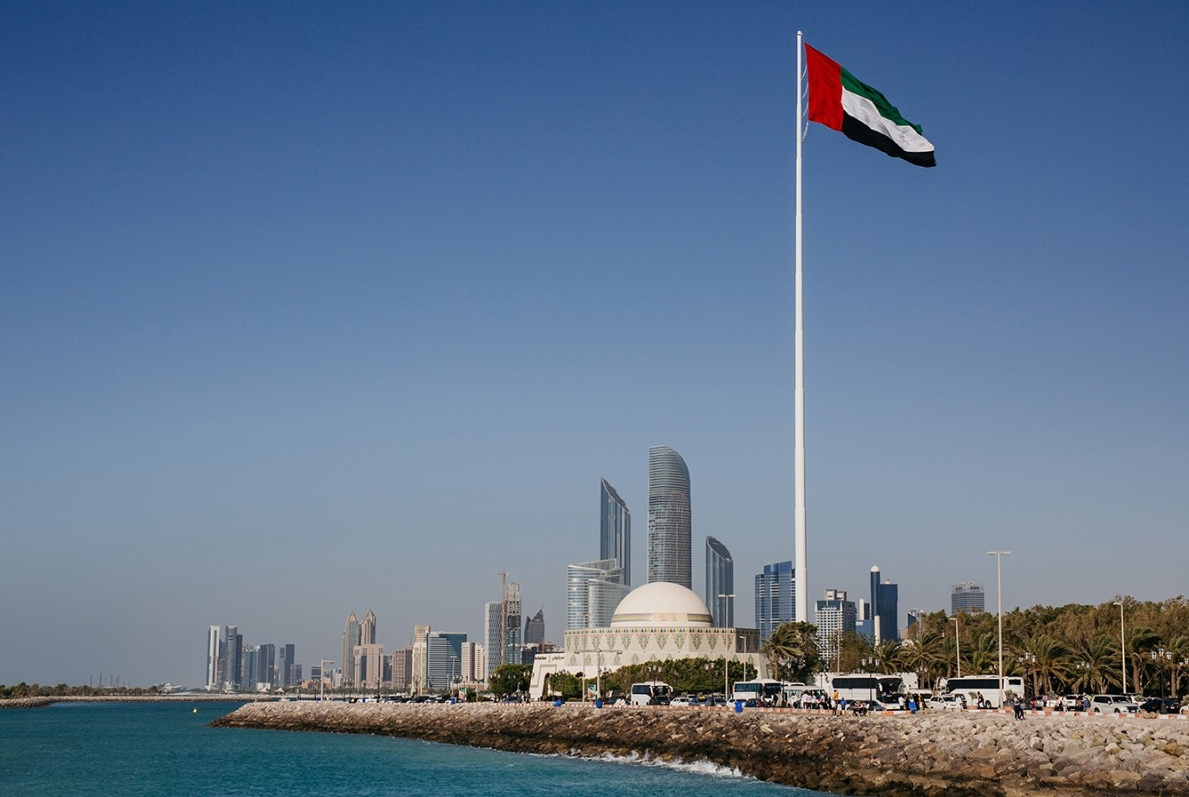 The view of Abu Dhabi along the corniche, with the UAE flag flying high.