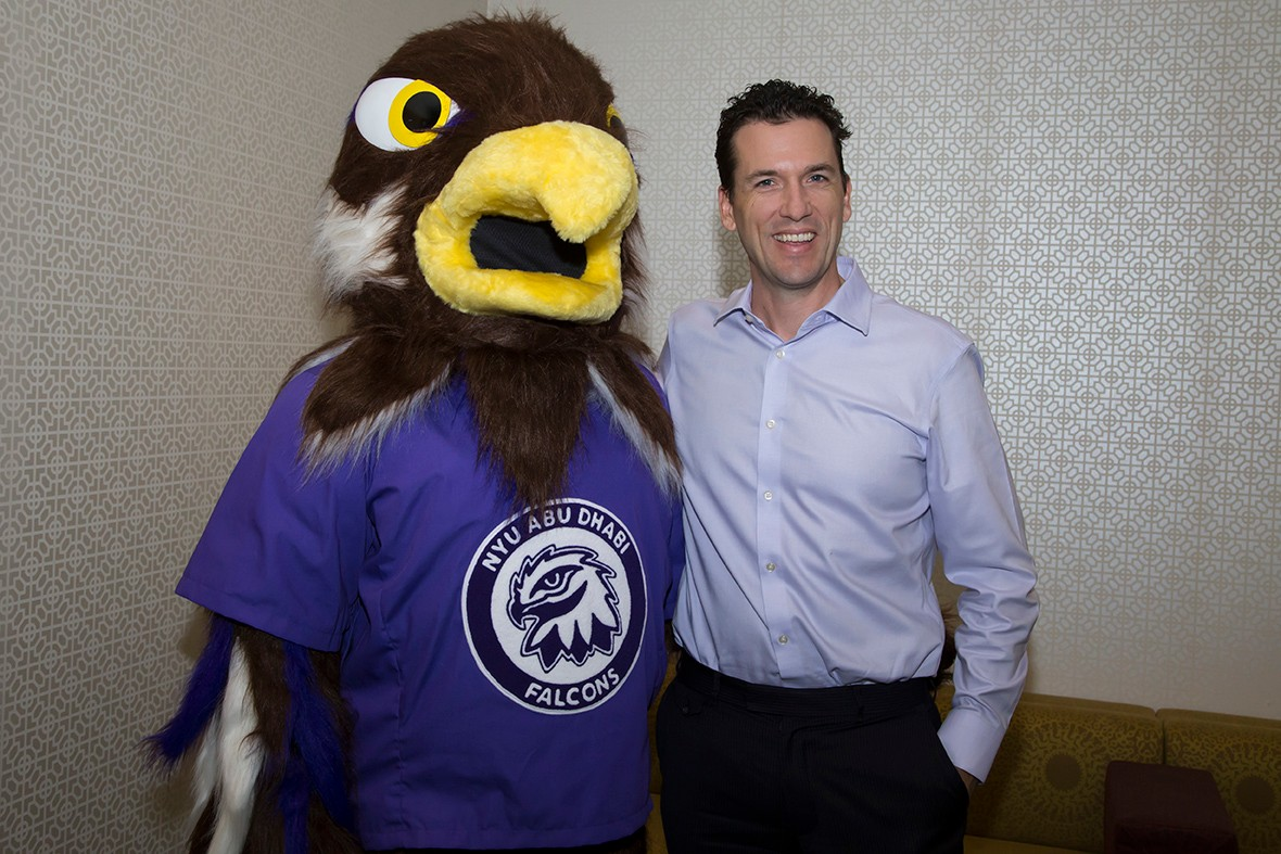 NYUAD's new Falcon mascot meets with Associate Vice Chancellor for Student Affairs and Dean of Students Kyle Farley.