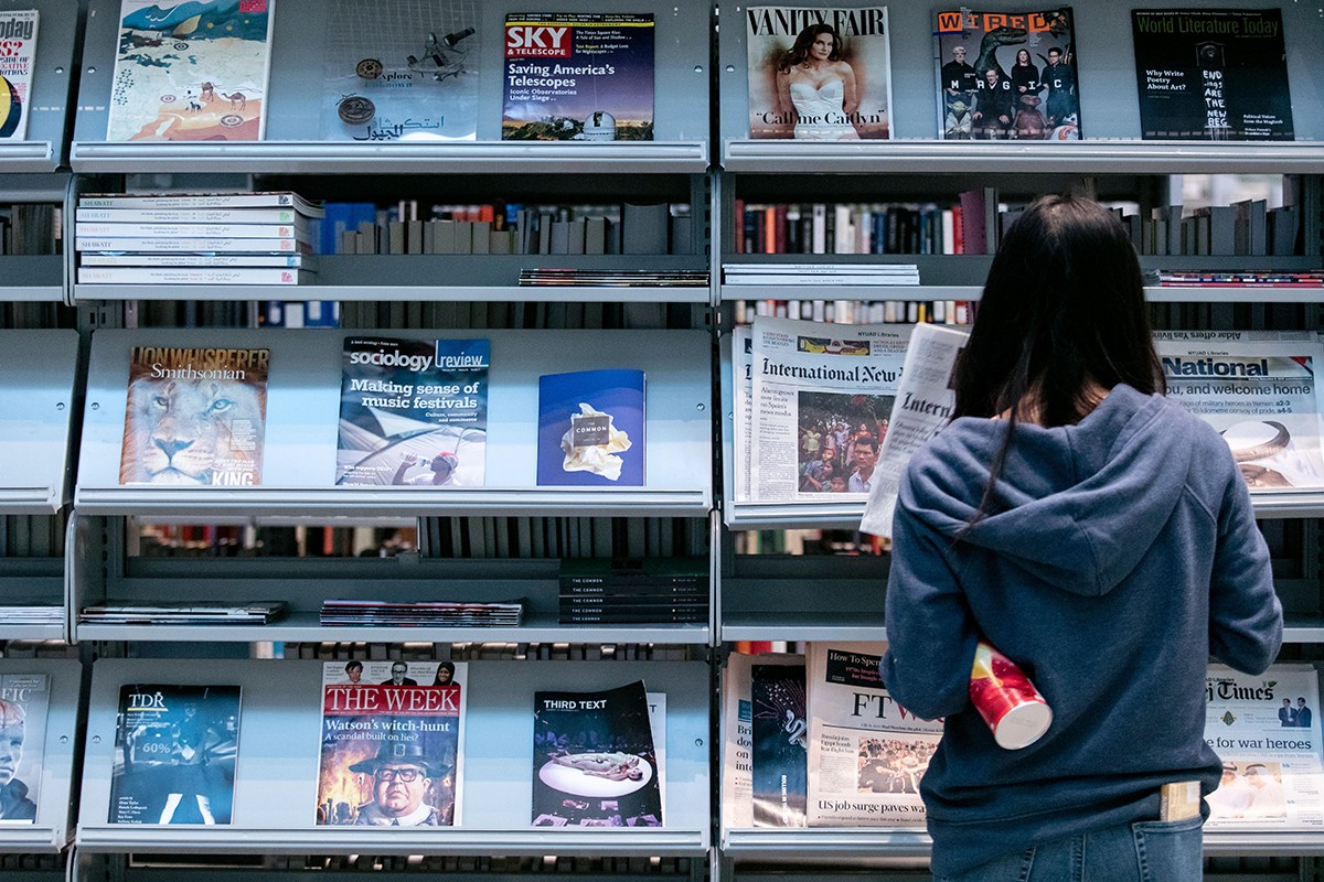 The periodicals and leisure reading section of the NYUAD Library.