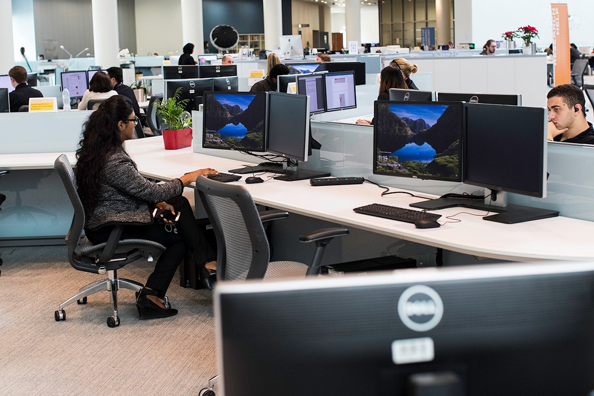 Students, faculty, and staff use workstations at the NYUAD Library.
