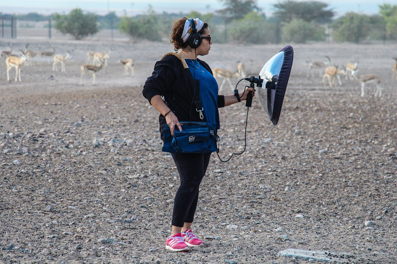A student captures sounds of wildlife for a class project at Sir Bani Yas Island, the UAE's largest wildlife preserve.