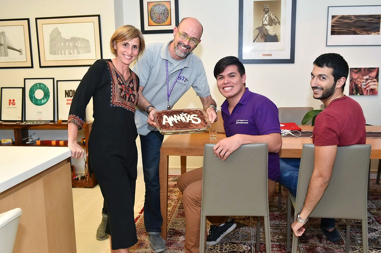 Assistant Professor of Practice of Visual Arts Goffredo Puccetti (second from left), Residential College Director Robert Leary (third from left), and Roberto El Khoury, Class of 2015 (far right).