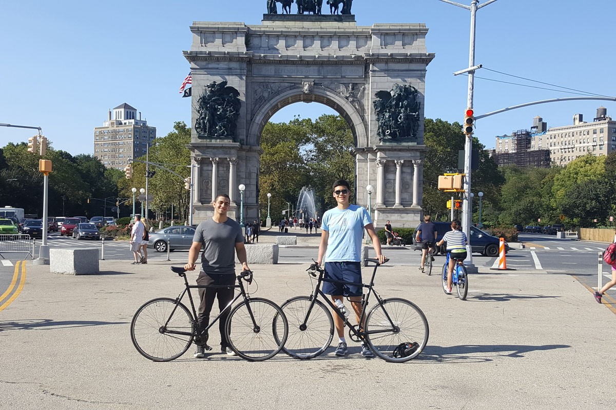 Engineering student William Young (left), Class of 2018, and a friend with their bikes at Washington Square Park in NYC.