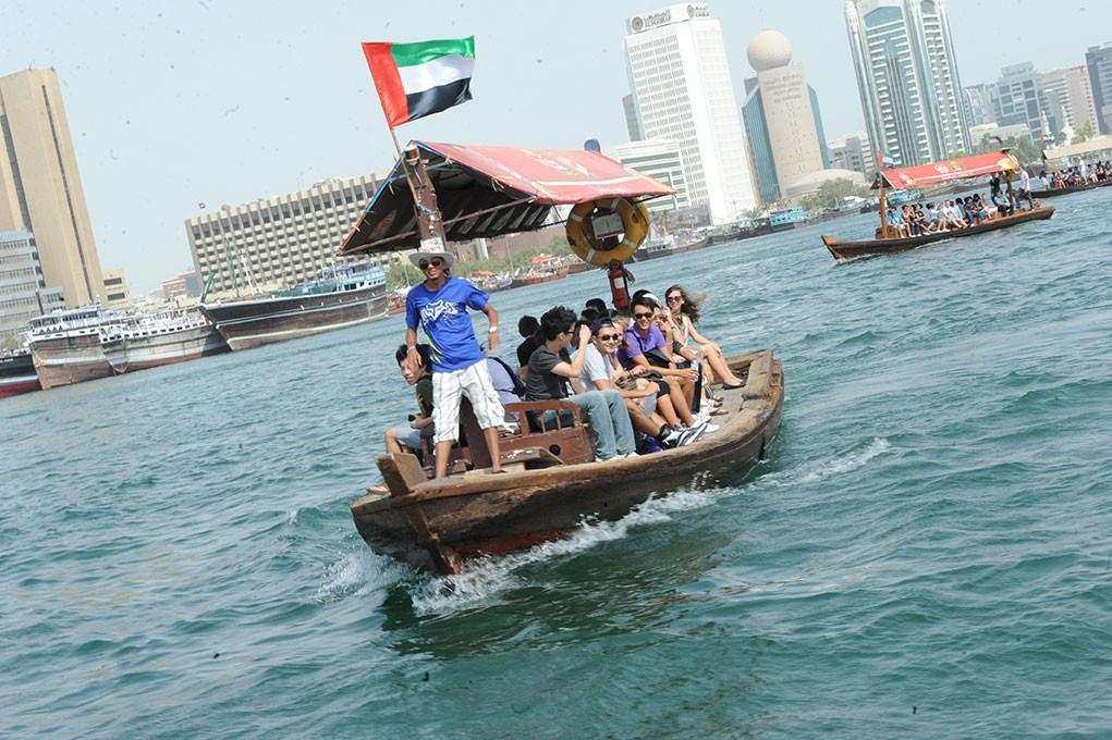 Students ride a traditional boat in Abu Dhabi.