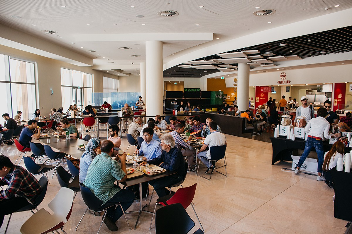 Students dining in the Campus East Restaurant (D2).