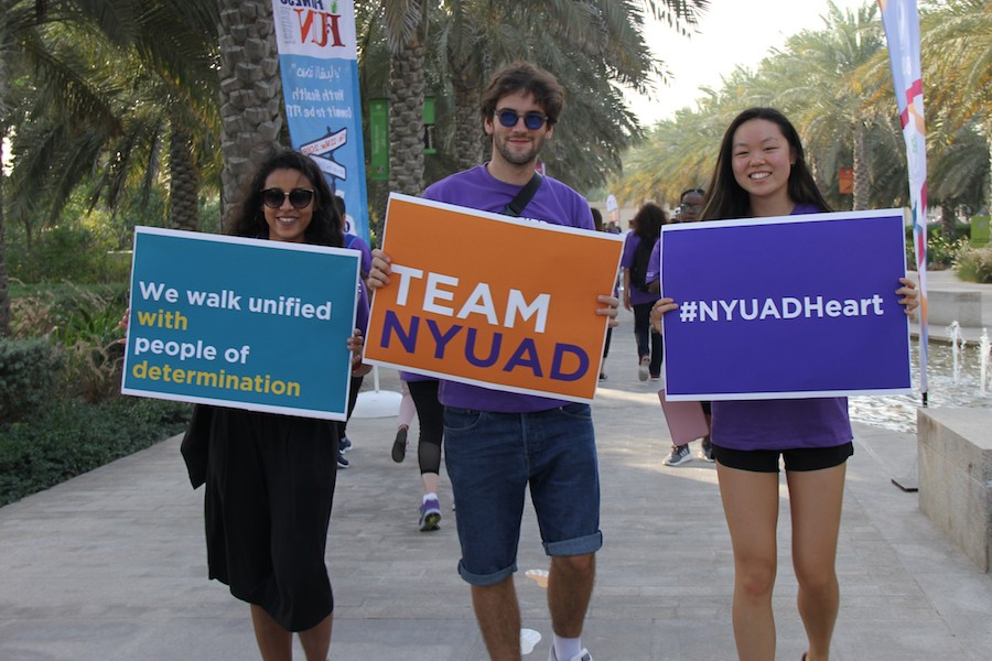 NYUAD community members participate in the Walk Unified event to mark the Special Olympics and show support for people of determination.