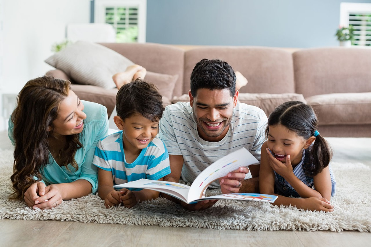 A family reading together in the living room. iStock