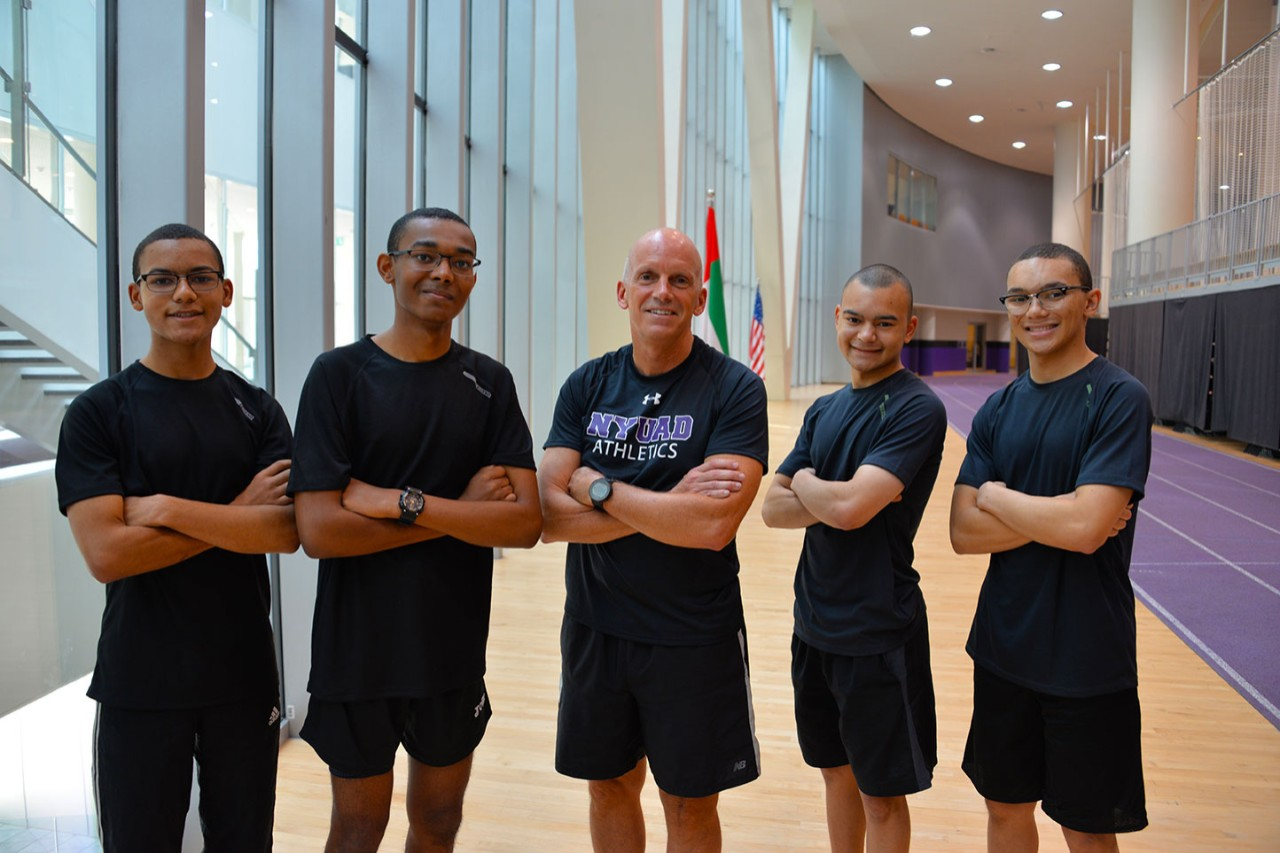 Running program athletes with NYUAD coach Wayne Young. (L-R) Michah Hambleton; Jonah Hambleton; coach Wayne Young; Issac Hambleton; Joel Hambleton.  Courtesy of Cassie Hambleton