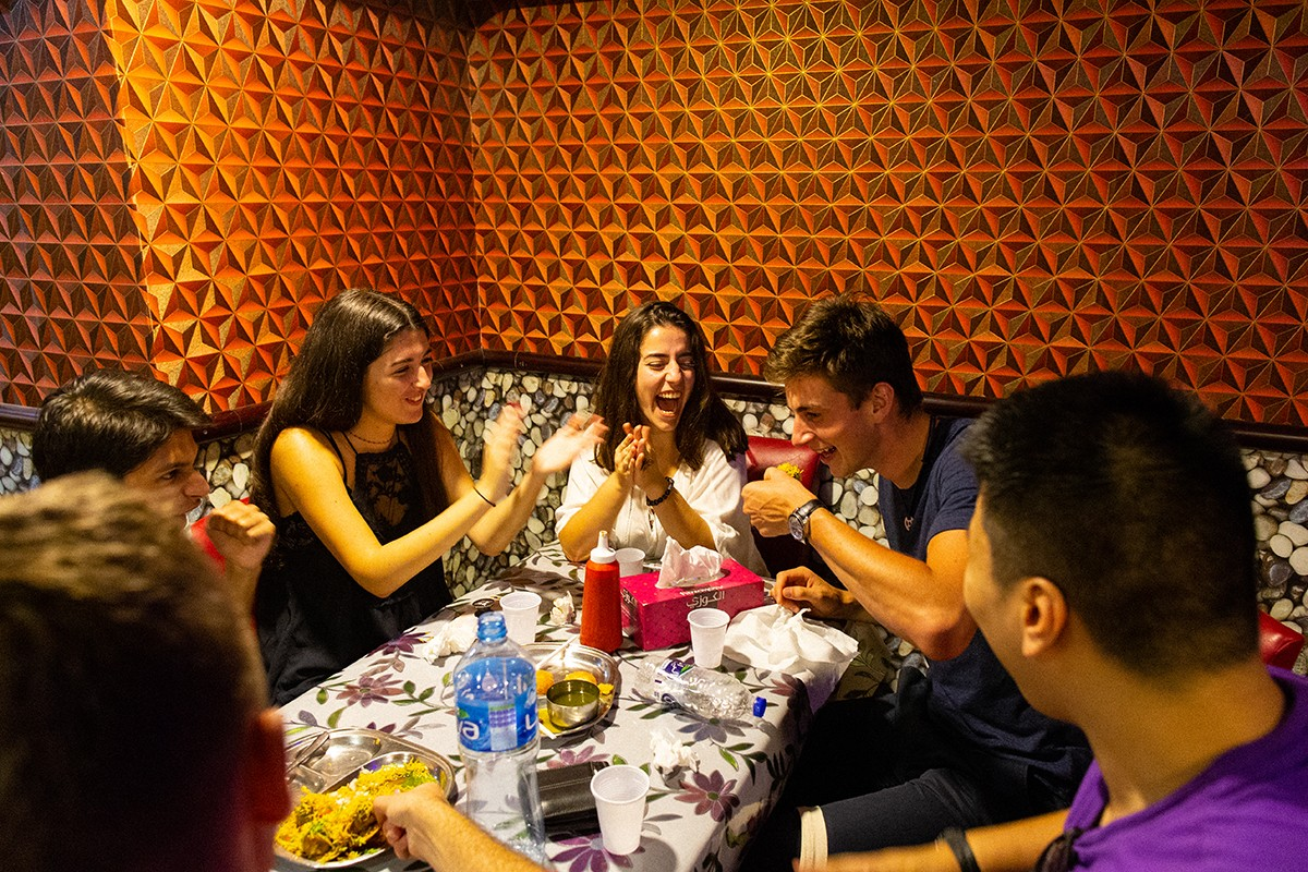 NYU Abu Dhabi students enjoy a meal together at a restaurant in Abu Dhabi.