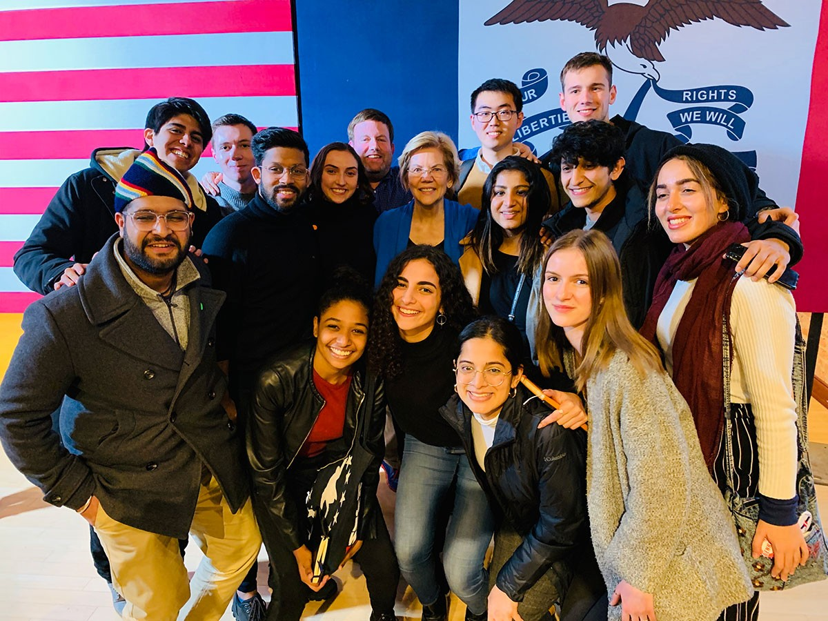 NYU Abu Dhabi students posed for a photo opportunity with United States presidential candidate Elizabeth Warren (center in blue) during their trip to the United States.