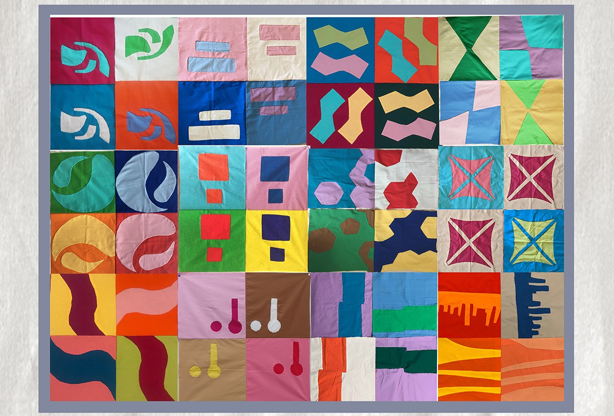 The compiled image of all the appliques inspired by architecture arranged in a quilt pattern.