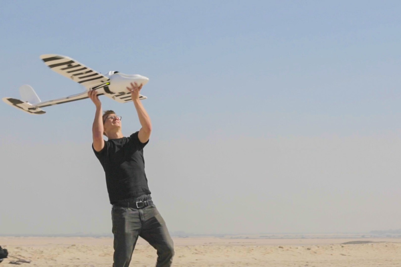 Martin Slosarik (Class of 2015) sends NYUAD's award-winning Wadi Drone into flight in a desert region near Abu Dhabi.