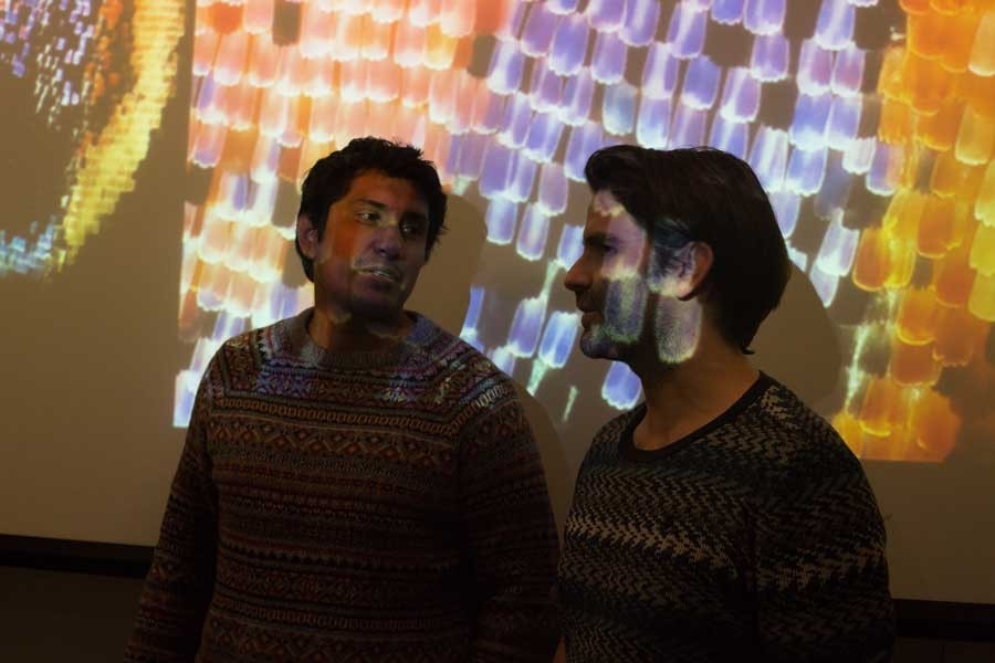 Actor Tenoch Huerta and Writer/Director Alexis Gambis test butterfly projections on screen. Photo credit: Renée Xie.