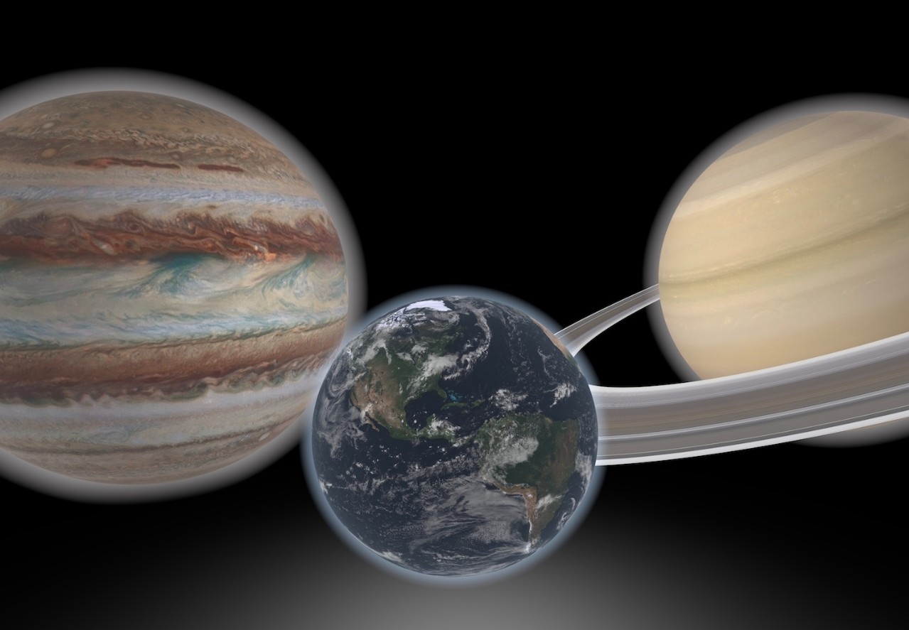 Artist concept shows a hypothetical Earth-like planet and two giant neighbors.