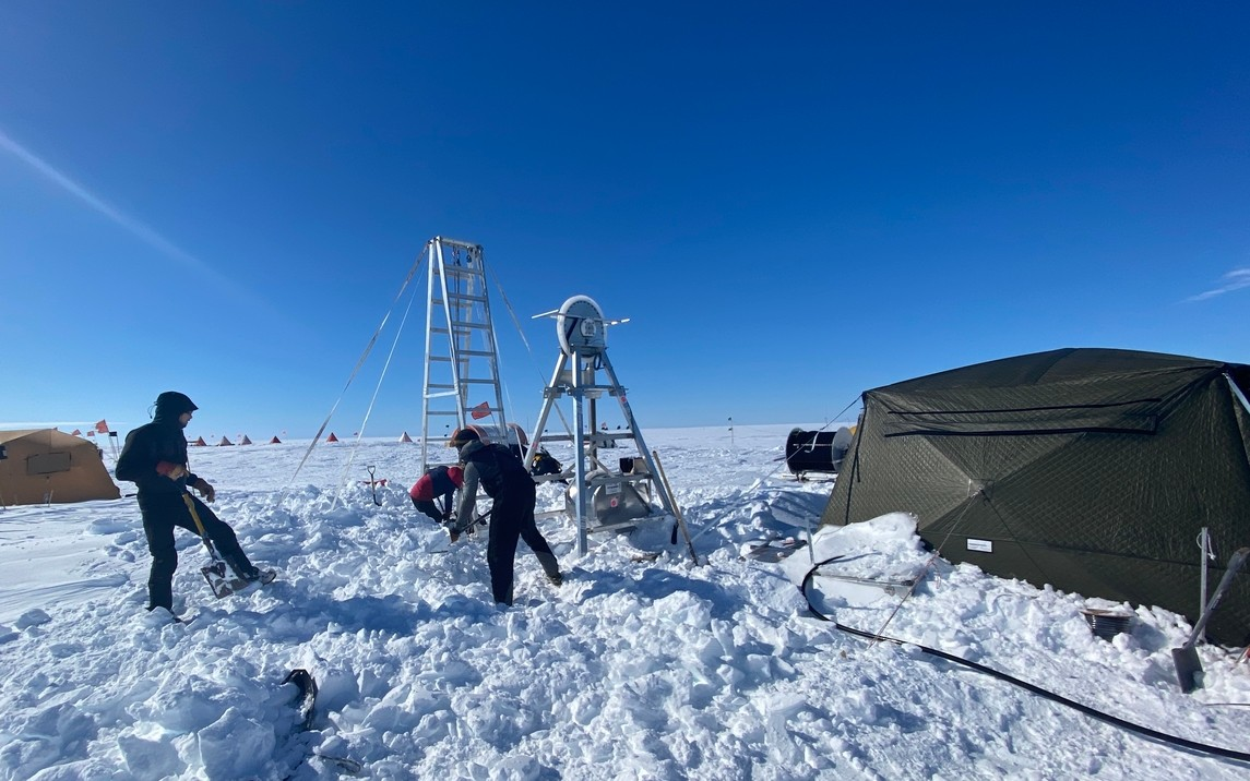 Researchers digging out the drill site after a three-day storm with winds reaching 50 knots. Drifts of snow accumulated up to five feet