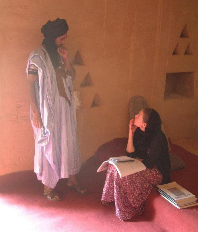 Erin Pettigrew, NYUAD assistant professor of history, talks to a man in Mauritania for research into the country's political history.