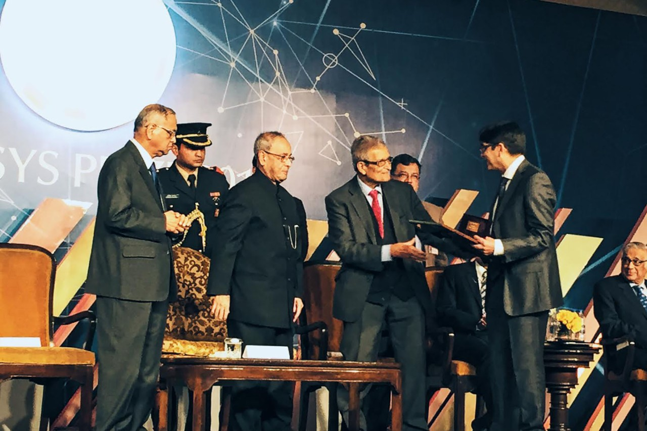 NYUAD philosophy professor Jonathan Ganeri accepts the Infosys Prize at a ceremony in India.