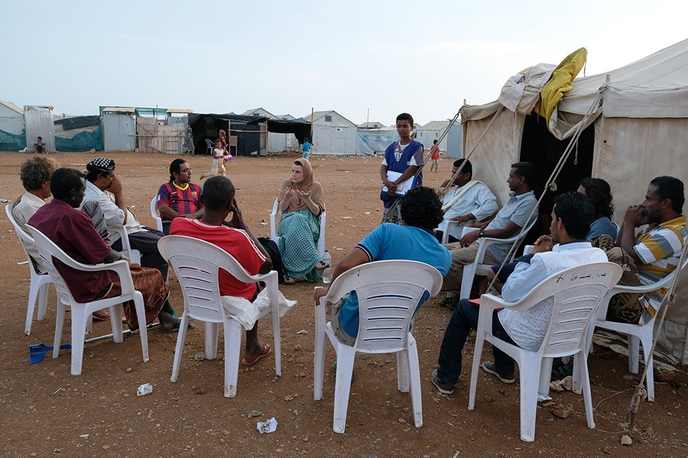Peutz sits down with several male Yemeni refugees to talk about their experiences. Nadia Benchallal/photographer