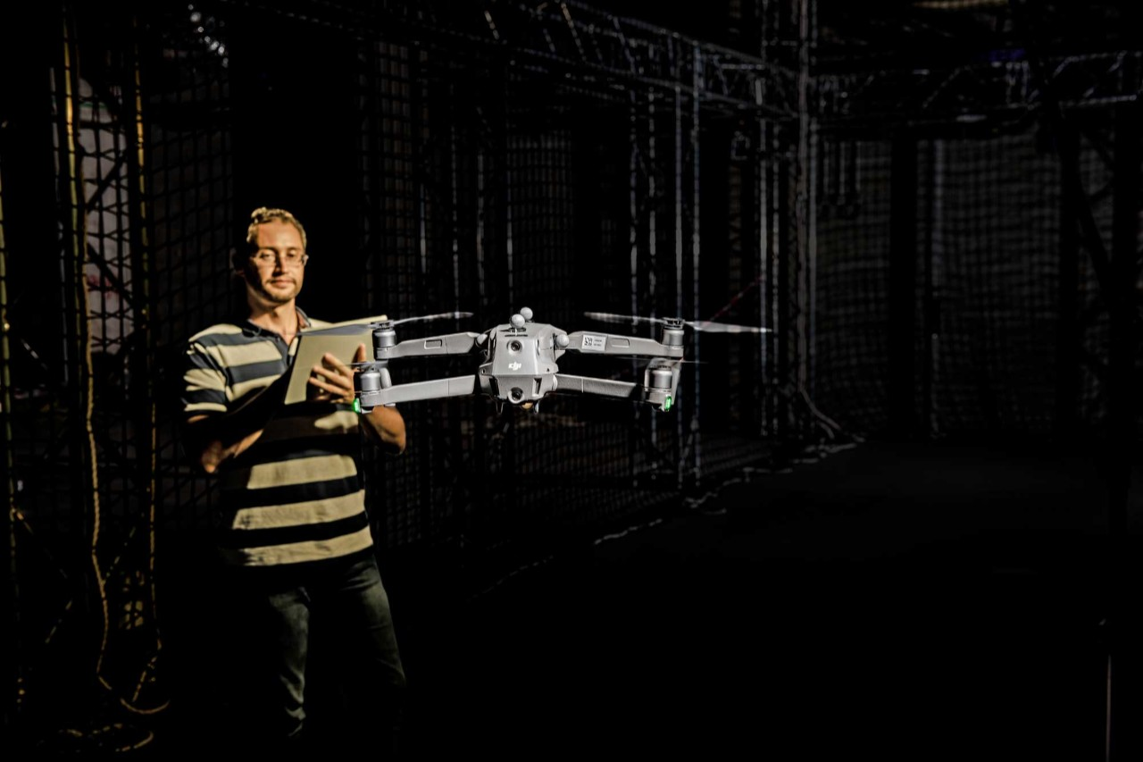 A researcher tests autonomous drones in a lab at NYU Abu Dhabi.
