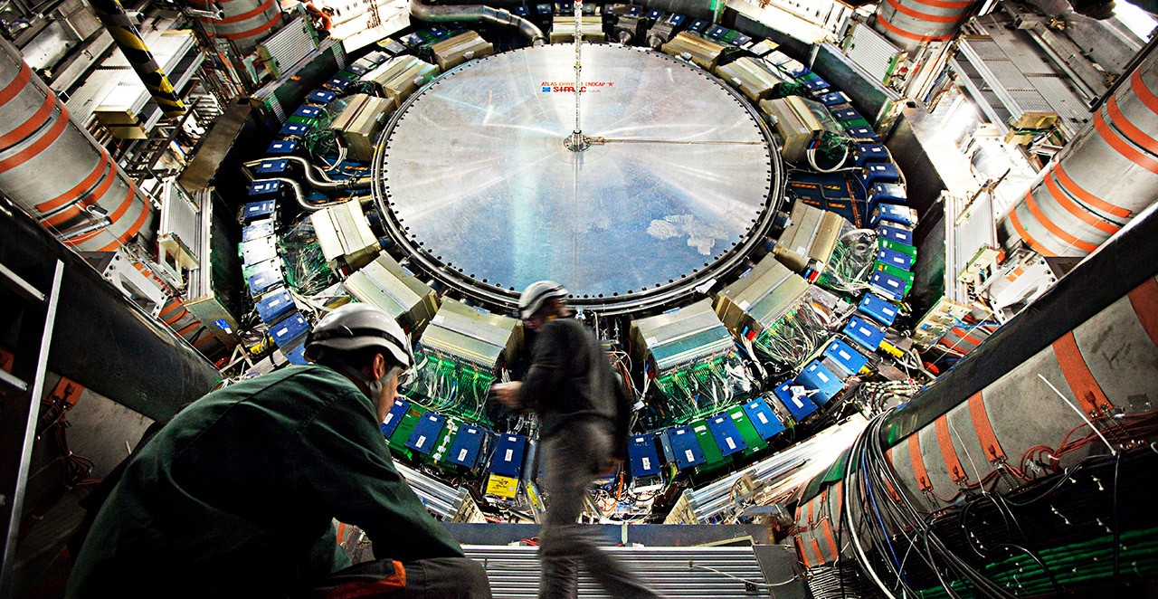 Engineers working on the large hadron collider for the Atlas project.